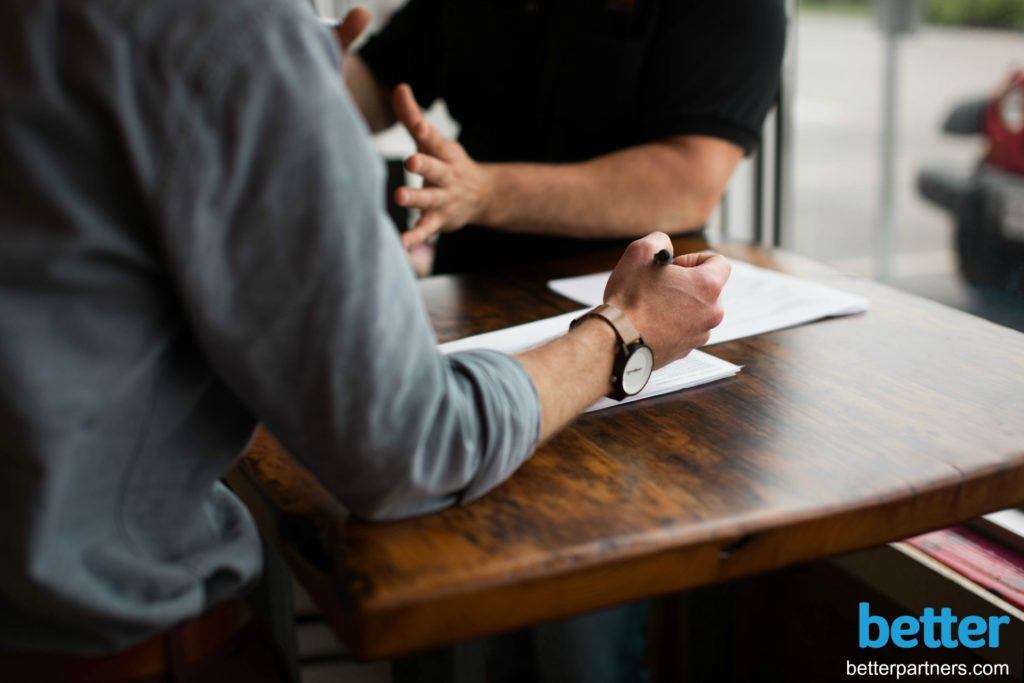 Better-Partners-Salesforce-data-wooden-table-hands